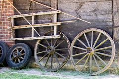 Old wooden wheels for horse cart. Open-air museum where various Stock Images