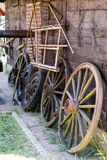 Old wooden wheels for horse cart. Open-air museum where various Stock Photos