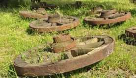 Old wooden wheels. Lie on the grass stock image
