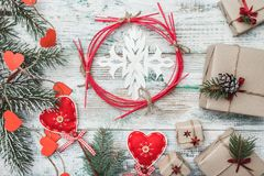Old wooden white background. Fir tree with red hearts. Greeting card for Christmas, Christmas, New Year and Xmas. Handmade items. Many gifts. Xmas and Happy Stock Photo