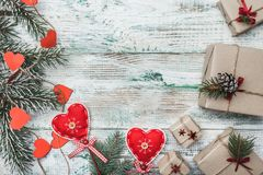 Old wooden white background. Fir tree with red hearts handmade. Greeting card for Christmas. Space for Santa`s message and holidays. Many gifts. Xmas and Happy Stock Photo