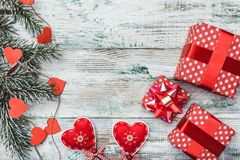 Old wooden white background. Fir tree with red hearts. Space for Santa`s message and holidays. Royalty Free Stock Photography
