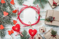 Old wooden white background. Fir tree with red hearts. Space for Santa`s message. Christmas greeting card, Handmade items. Many gifts. Xmas and Happy New Year royalty free stock photography