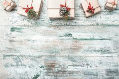 Old wooden white background. With modern texture. Space for Santa`s message. Christmas greeting card, Handmade items. Many gifts at the top. Xmas and Happy New royalty free stock photos