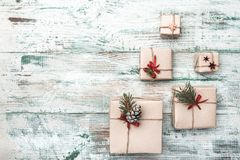 Old wooden white background. With modern texture. Space for Santa`s message. Christmas greeting card, Handmade items. Many modern gifts. Xmas and Happy New royalty free stock images