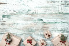 Old wooden white background. With modern texture. Space for Santa`s message. Christmas greeting card, Handmade items. Many gifts. Xmas and Happy New Year royalty free stock photography