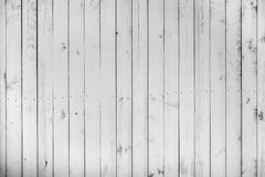 Old wooden white color wall, lot of cracks, limbs and nails, wea. Thered dark messy dust background with rich texture, timber planks. Ukraine Stock Image