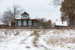 Old wooden willage house under snow Stock Photos
