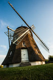 Old wooden wind mill. Old wooden Danish wind mill on grass Royalty Free Stock Image