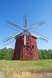 Old wooden windmill. Traditional old wooden windmill painted in red color Stock Images