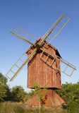 Old wooden windmill. Old traditional wooden windmill in rural area stock images