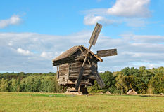 Old wooden windmill. At ethnographic museum, Ukraine Stock Photo