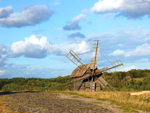 Old wooden windmill. At ethnographic museum, Ukraine Royalty Free Stock Images