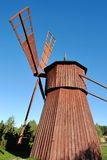 Old Wooden Windmill. Side view of small red wooden windmill Royalty Free Stock Image
