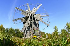 Old wooden windmill. On the edge of the forest with a blue sky Royalty Free Stock Image