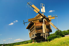 Old wooden windmill. Old ukrainian windmill in museum Pirogovo Royalty Free Stock Image