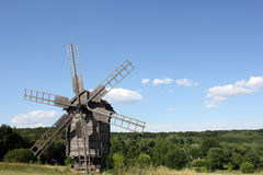 Old wooden windmill. Against the background of summer nature Stock Photo