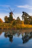 Old wooden windmill in autumn's environment Royalty Free Stock Images