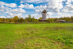 Old wooden windmill in autumn season Stock Images