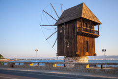 Old wooden windmill on the coast, old Nesebar town, Bulgaria Royalty Free Stock Image