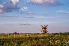 Old wooden windmill in a deserted field. Landscape, Arkaim, Russia. Alone windmill in desolate field, old wooden windmill in a deserted field. Landscape, Arkaim Stock Photography