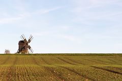 Old windmill by a farmers corn field Royalty Free Stock Photo