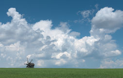 Old wooden windmill on the horizon. Stock Images