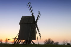 Old wooden windmill on the island Oeland. Old wooden windmill near the village Resmo on the island oland, Sweden, in the evening light of a late october day Stock Image