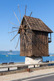 Old wooden windmill on the sea coast, the most popular landmark Stock Photography