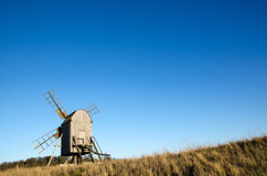 Old wooden windmill. Sunlit old traditional wooden windmill on at the swedish island Oland, the island of sun and wind Royalty Free Stock Images