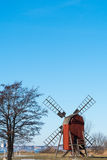 Old wooden windmill. Sunshine on the old wooden windmill, a typical symbol for the swedish island Oland - the island of sun and wind in the Baltic Sea Stock Photos