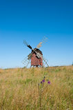 Old wooden windmill in Sweden. Old red painted wooden windmill on the island Oland, Sweden. The mill is windmill of post mill type an one of the more than 200 Royalty Free Stock Photo