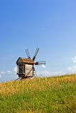 Old wooden windmills. At Pirogovo ethnographic museum, near Kyiv, Ukraine Royalty Free Stock Photos