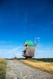 Old wooden windmills. At Pirogovo ethnographic museum, near Kyiv, Ukraine Royalty Free Stock Photography