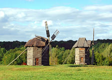 Old wooden windmills. At ethnographic museum, Ukraine Royalty Free Stock Images