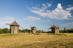 Old wooden windmills with a broken roof Stock Photo