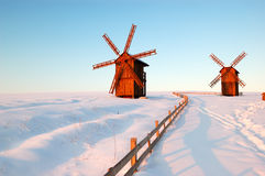 The old wooden windmills during sunset Stock Photo