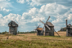 Old wooden windmills. Old wooden windmills in the village are in the field Royalty Free Stock Photos