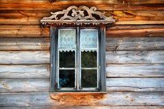 Old wooden window. Window of antique, wooden slav house. Nowogrod Heritage Park, Masuria, Poland Stock Photography
