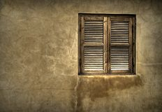Old wooden window. An old wooden window in a textured wall Royalty Free Stock Photography