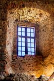 An old wooden window in an ancient castle in a brick wall_. An old wooden window in an ancient castle in a brick wall stock photography