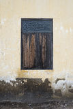 Old wooden window on ancient cement wall,natural color picture style,texture background Royalty Free Stock Photos