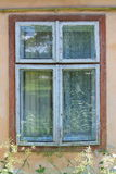 Old wooden window on ansient house. Old wooden window on old (ansient) house stock photography