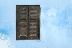 Old wooden window with black shutters. stock photography