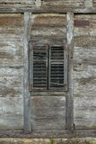 Old wooden window with wooden blinds. On an abandoned wooden house Stock Photo