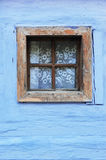 Old wooden window on blue wall Royalty Free Stock Image