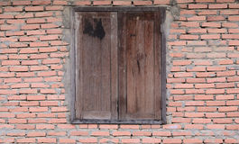 Old wooden window. On brick wall Royalty Free Stock Photography