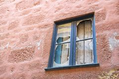 Old wooden window with broken glass stock photography