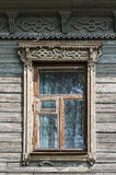 Old wooden window with carved architraves Royalty Free Stock Images