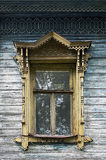 Old wooden window with carved platbands Stock Images